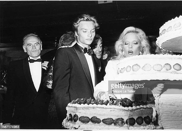 Sylvie Vartan celebrates twenty years of songs in Maxim's restaurant, with Pierre Cardin and David Hallyday, Paris, France, 1984.