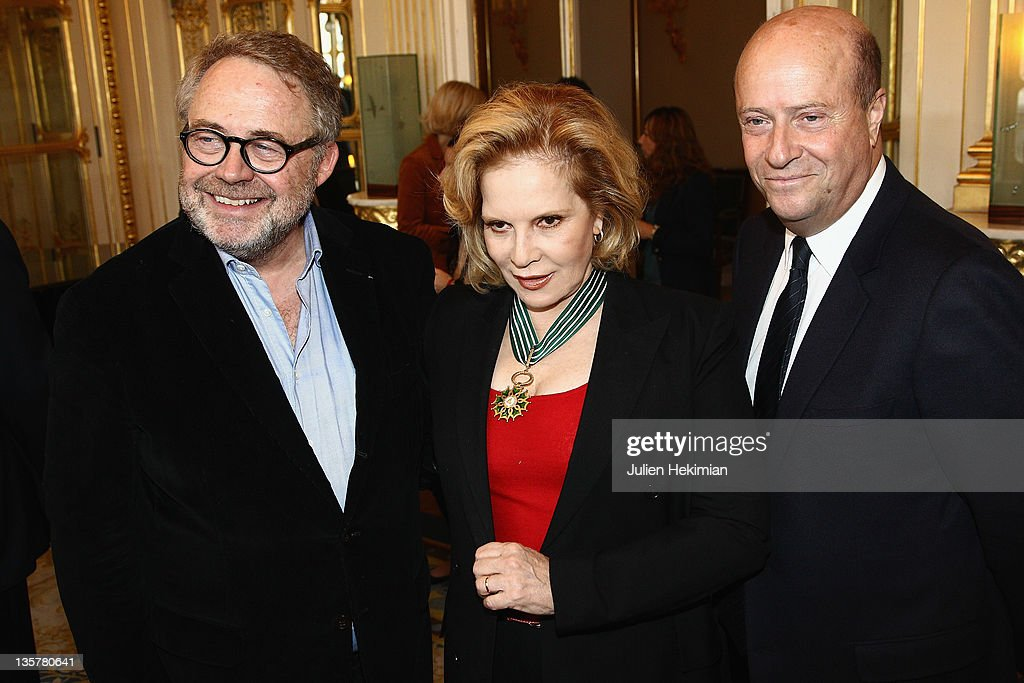 Sylvie Vartan is pictured with Dominique Segall (L) and guest after being awarded Commandeur des Arts et Lettres at Ministere de la Culture on December 14, 2011 in Paris, France.