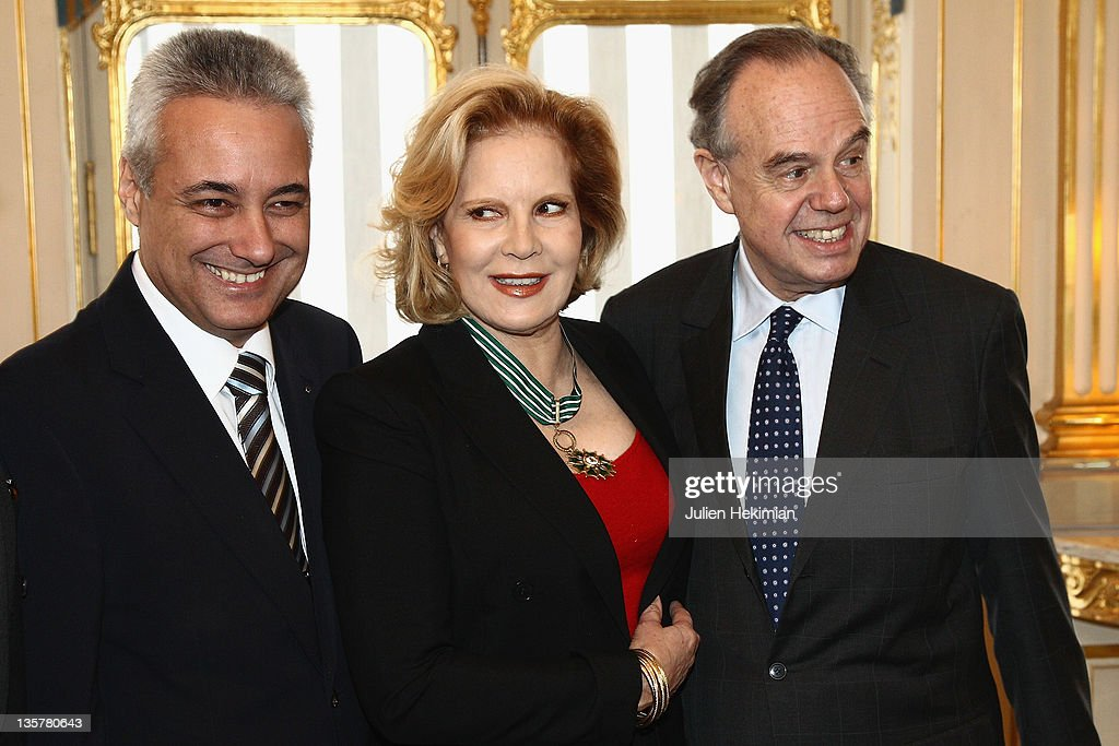 Sylvie Vartan is pictured with French Minister for Culture Frederic Mitterrand (R) and Ambassador for Bulgaria Marin Raykov (L) after being awarded Commandeur des Arts et Lettres at Ministere de la Culture on December 14, 2011 in Paris, France.