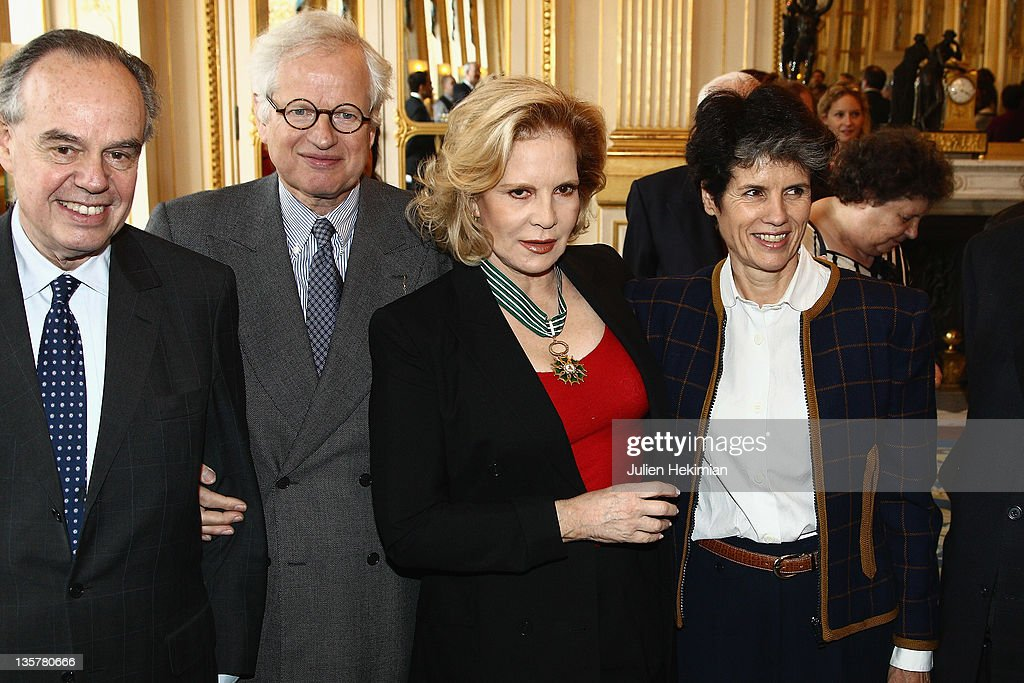 Sylvie Vartan is pictured with French Minister for Culture Frederic Mitterrand (L), Valerie-Anne Giscard d'Estaing (R) and Bernard Fixot pose after Sylvie Vartan was awarded Commandeur des Arts et Lettres at Ministere de la Culture on December 14, 2011 in Paris, France.