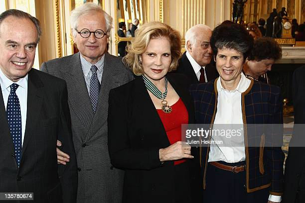 Sylvie Vartan poses with French Minister for Culture Frederic Mitterrand ValerieAnne Giscard d'Estaing and Bernard Fixot after she was awarded...
