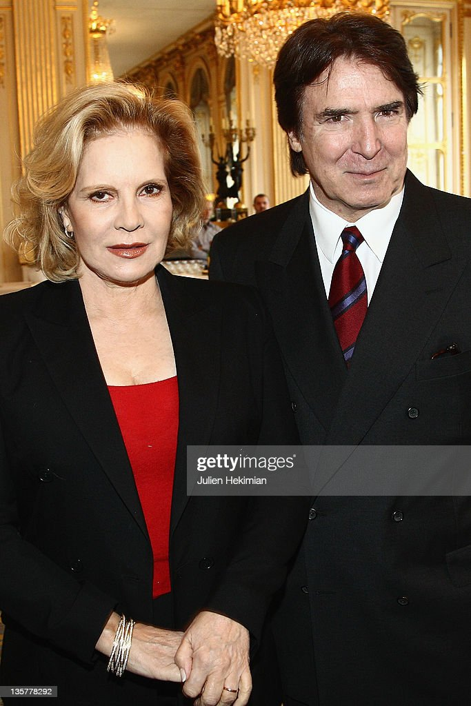 Sylvie Vartan (L) poses with her husband Tony Scotti before being awarded Commandeur des Arts et Lettres at Ministere de la Culture on December 14, 2011 in Paris, France.