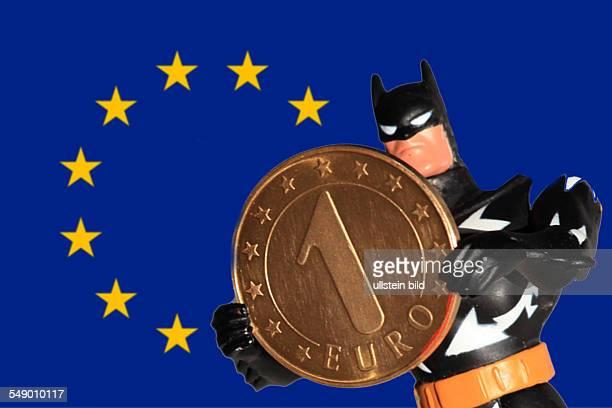 """Symbol Eurokrise, Probleme um die Gemeinschaftswaehrung Euro sind nur noch von """"Batman"""" zu bewaeltigen. Spielzeugfigur stemmt eine symbolische..."""