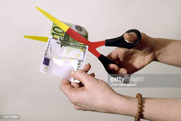 GERMANY BONN Symbol image blackredgolden scissors cut 100 Euro bank note