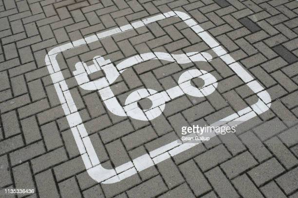 A symbol marks a charging spot for electric cars at a public parking lot near the Volkswagen factory on March 12 2019 in Wolfsburg Germany Volkswagen...