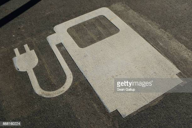 A symbol marks a parking spot for electric cars at a charging station at a rest area along the A9 highway on December 7 2017 near Ingolstadt Germany...