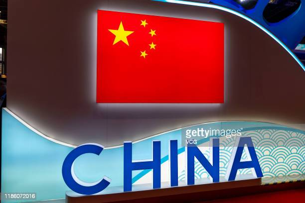Symbol of China and China's flag are pictured during the 2nd China International Import Expo at the National Exhibition and Convention Center on...