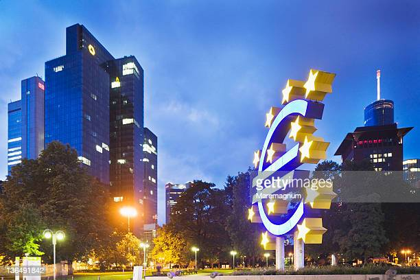 symbol of euro and skyscraper galileo - european central bank stock photos and pictures