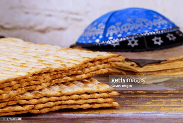 symbol of passover plate, matza with kipah in the pesah celebration - jewish prayer shawl stock pictures, royalty-free photos & images