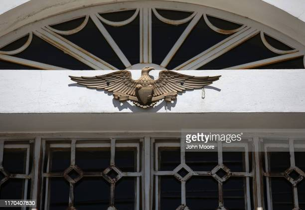 A symbol of the US bald eagle adorns the front of a remittance house on August 25 in Salcaja Guatemala Neighbors said the home was built by money...