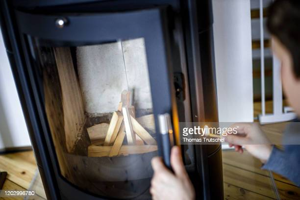 Symbol photo A woman lights a stove with a matchstick on February 21 2020 in Berlin Germany