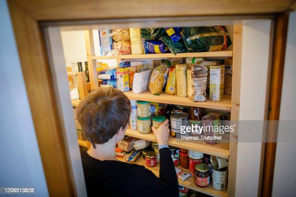 Symbol photo A woman stands in front of a shelf with supplies of various foods on March 11 2020 in Berlin Germany *** As part of the spread of the...