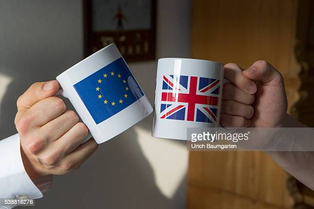 Symbol photo about proposed referendum on United Kingdom membership of the European Union The photo shows hands with coffee pots on which the flags...