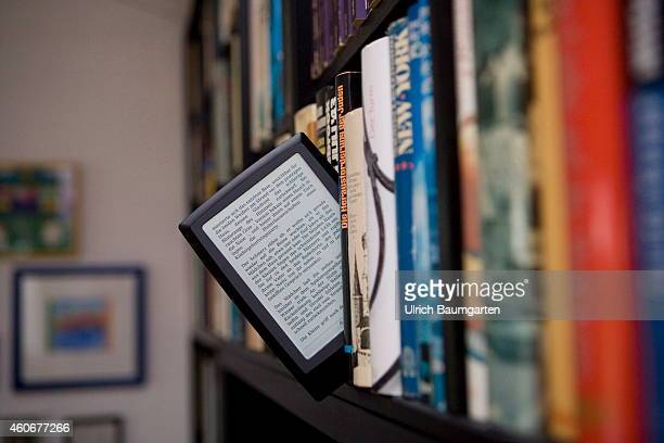 Symbol photo battle for supremacy in the book market Our picture shows an eBook between bound books in a bookcase on December 19 2014 in Bonn Germany