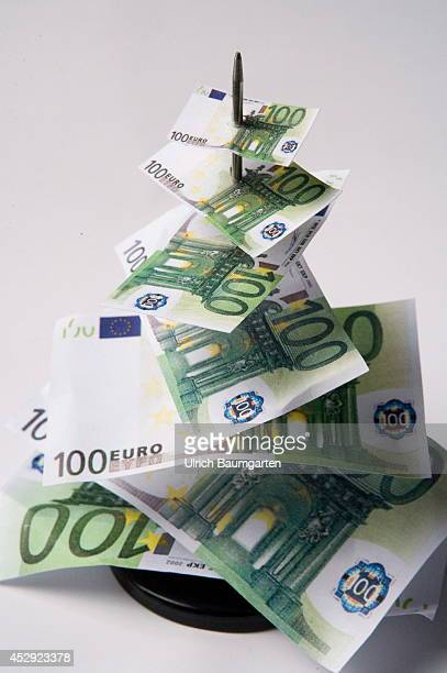 Symbol photo inflation What is our money tomorrow still worth Skewered 100 Euro Banknotes of normal size to verry small on July 30 2014 in Bonn...