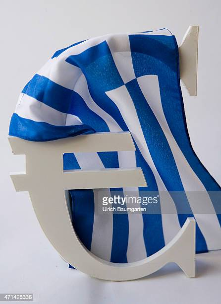 Symbol photo on Greece and the Eurozone Our picture shows the Euro currenca symbol with the Greek flag
