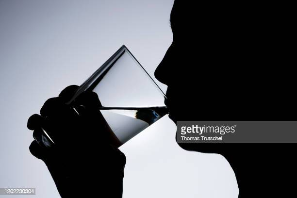Symbol photo on the subject of drinking water a woman drinking water from a glass on February 20 2020 in Berlin Germany