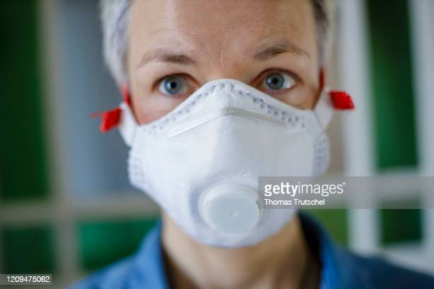 Symbol photo on the subject of prevention A woman is wearing a respirator on April 05 2020 in Berlin Germany Many people currently equip themselves...