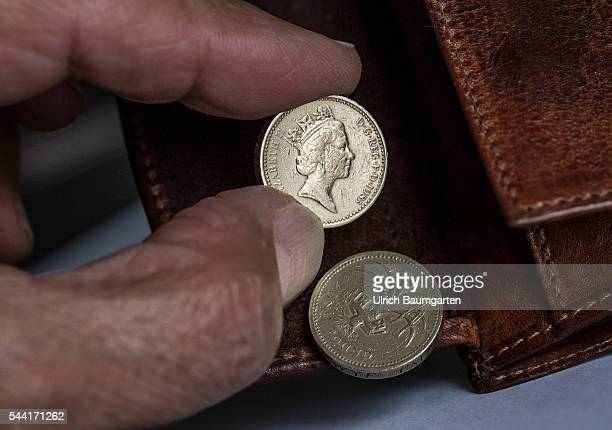 Symbol photo on the subjects Brexit British Pounds Sterling Dollar financel market stock exchange etc The photo shows a wallet with a British 1...