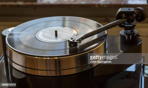 Symbol photo on the theme Renaissance of the records The photo shows the detail of a record player with tone arm and a record