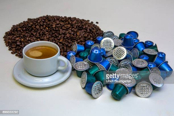 Symbol photo on the topic coffee enviroment waste etc The picture shows coffee beans coffee capsules and a cup of coffee