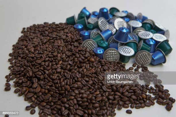 Symbol photo on the topic coffee enviroment waste etc The picture shows coffee beans and coffee capsules