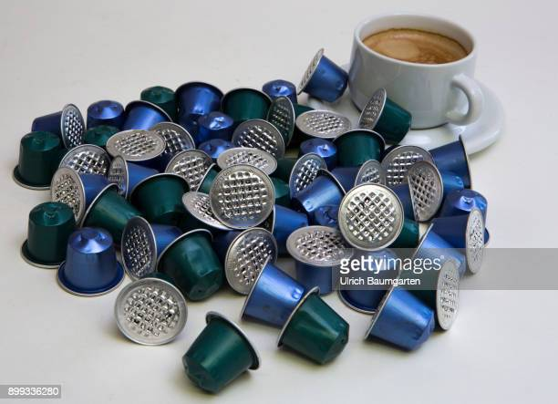 Symbol photo on the topic coffee enviroment waste etc The picture shows coffee capsules and a cup of coffee