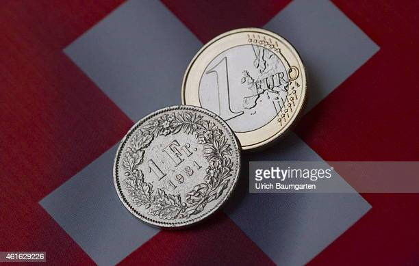 Symbol photo on the topic currency turbulence Our picture shows a 1 Euro coin and a 1 Swiss franc coin with the flag of Switzerlandon January 16...