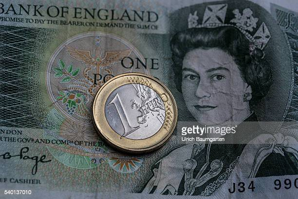 Symbol photo on the topic proposed referendum on United Kingdom membership of the European Union The photo shows a one Euro coin on a British one...