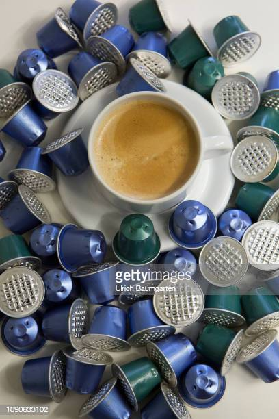 Symbol photo on the topics coffee capsules aluminium garbage environmental pollution etc The picture shows a filled coffee cup framed by aluminium...