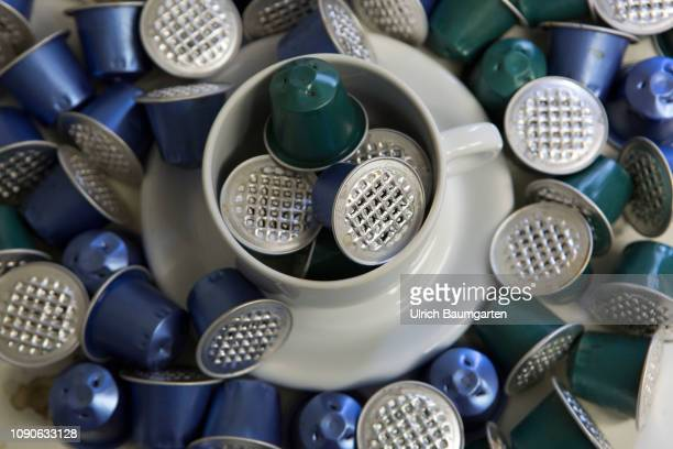 Symbol photo on the topics coffee capsules aluminium garbage environmental pollution etc The picture shows a coffee cup filled and framed with...