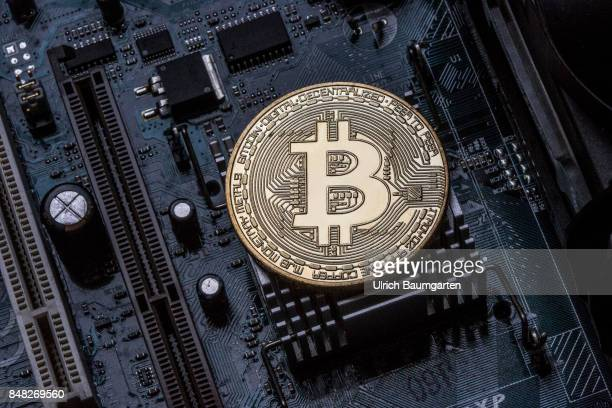 Symbol photo on the topics of Bitcoin Crypto currency financial speculation digital currency etc Bitcoin on a computer board
