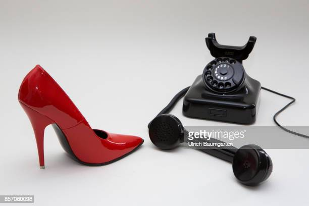 Symbol photo on the topics phone sex prostitution loneliness etc The photo shows a red women's shoe and a dial phone