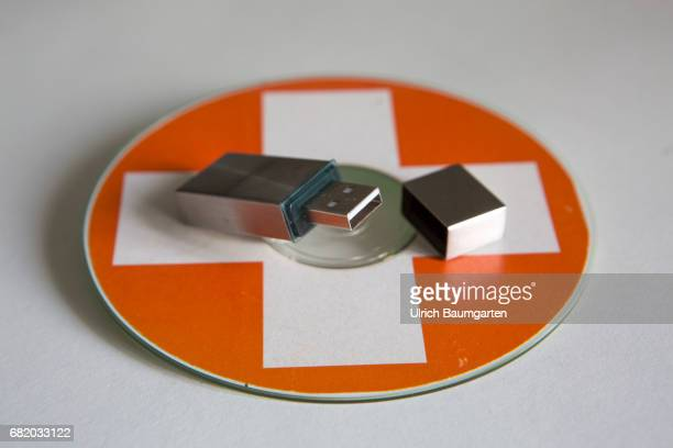 Symbol photo on the topics tax evasion, tax investigation, tax fraud, etc. The photo shows a USB stick on a CD with Swiss flag.