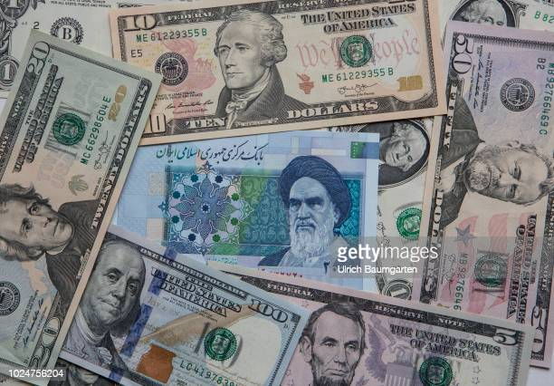 Symbol photo on the topics US sanctions against Iran Dollar Rial Toman rial devaluation inflation etc The photo shows an Iranian 20000 rial banknote...