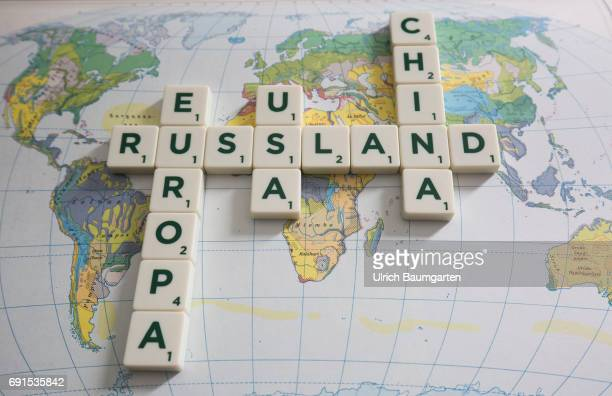 Symbol photo on the topics world policy world trade world economy etc The photo shows the words Russia Europe USA and China composed of scrabble...