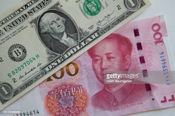 Symbol photo on the topics world trade trade war punitive tariffs etc The picture shows a one hundred yuan banknote and a one dollar banknote
