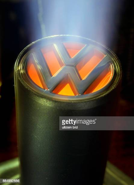 Symbol photo sybolized exhaust pipe with the VW emblem and fumes