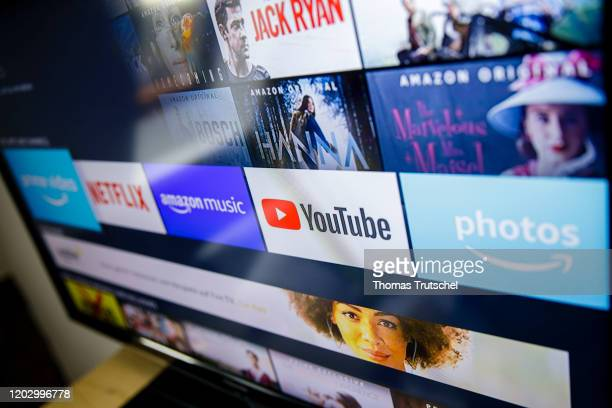 Symbol photo The logos of the streaming services Amazon Prime Video Netflix amazon music and youtube can be seen on a television on February 21 2020...