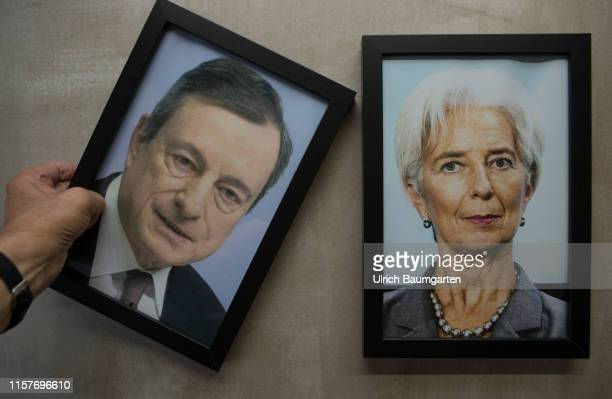 Symbol photo to the change of presidency of the European Central Bank Framed portrait photos by Christine Lagarde designated ECB President and Mario...