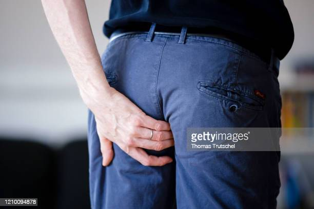 Symbol picture diarrhoea and flatulence. A man grabs his buttocks with his hand on April 13, 2020 in Berlin, Germany.