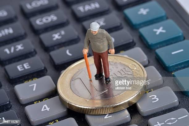 Symboldbild Miniaturfigur Geld Taschenrechner