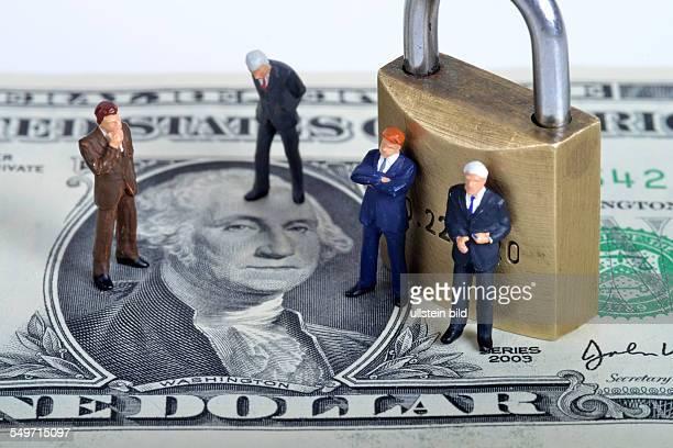 Symbolfoto Miniaturfiguren Dollar Sicherheit