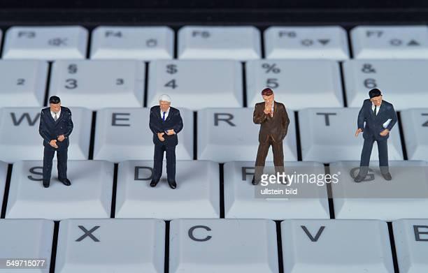 Symbolfoto Miniaturfiguren Tastatur Computer