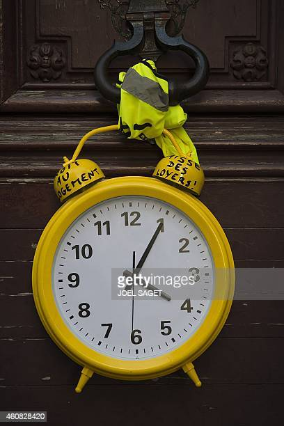 A symbolic alarm clock to call on the French Housing minister to 'wake up' is seen attached to the Housing Ministry's gate during a demonstration of...