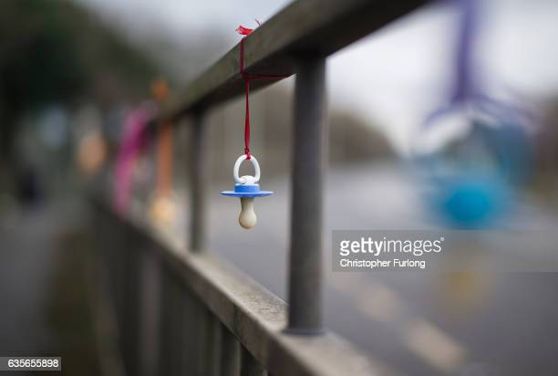 A symbolic children's dummy hangs from the railings outside West Cumberland Hospital where the maternity unit is under threat ahead of the Copeland...