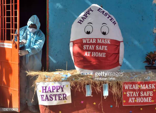 Symbolic egg about 4 feet in size was made for Easter to spread awareness about the Corona epidemic at Sion Koliwada, on April 3, 2021 in Mumbai,...