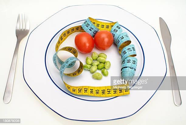 symbolic for diet, calorie - fastenzeit stock-fotos und bilder