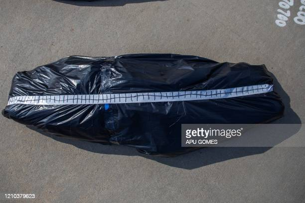 A symbolic homemade bodybag placed by RefuseFascism supporters in front of the Trump National Golf Club during an antiTrump protest is seen on April...
