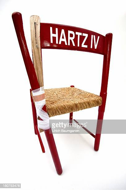 Symbolic image Hartz concept Broken chair with writing Hartz IV